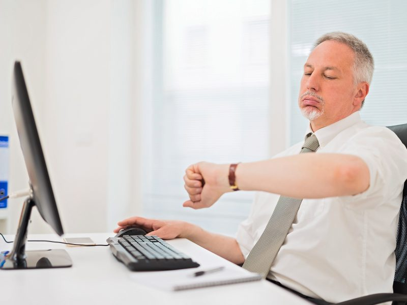 employee waiting for slow computer